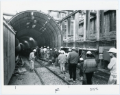 Employees tour the tunnel