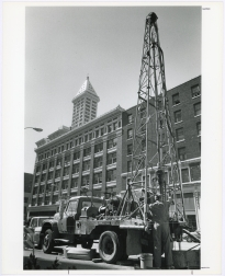 Drilling tests, with Smith Tower in the background